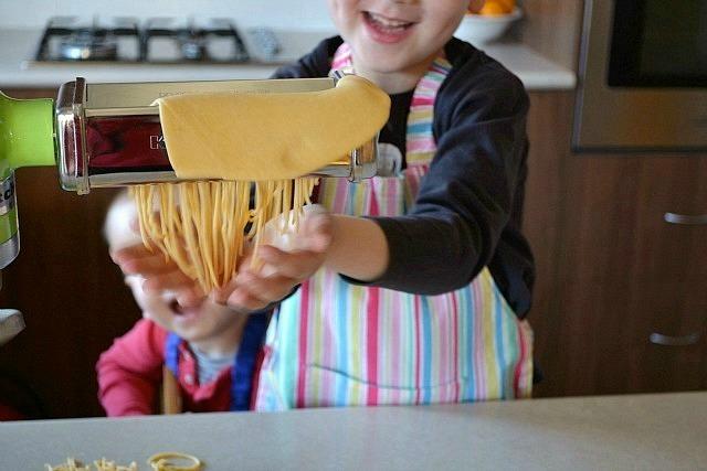 Caspar and Otis making pasta