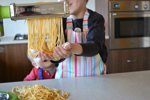 Caspar and Otis making spaghetti