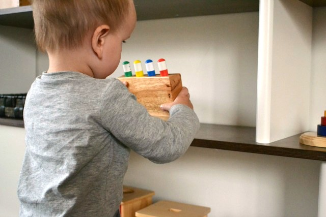 Putting things away and tidying up - each toy has it's own place on the shelves