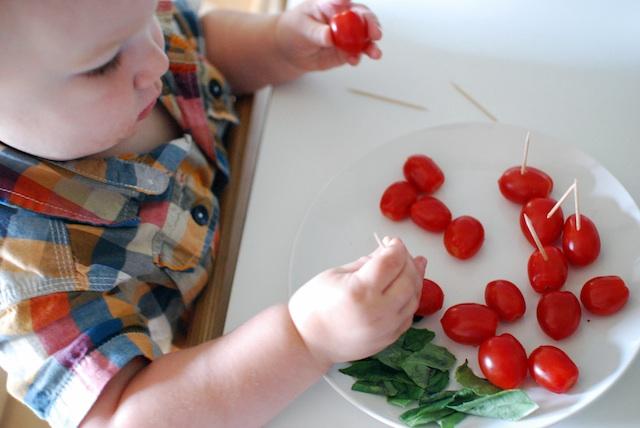 Henry making tomato:basil:mozzarella sticks