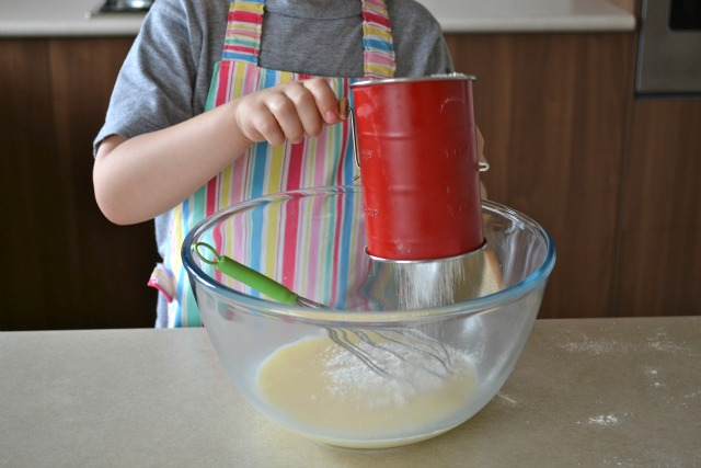 Caspar with child sized sifter and whisk