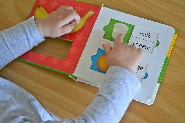 Point and name using 'first words' book for language development