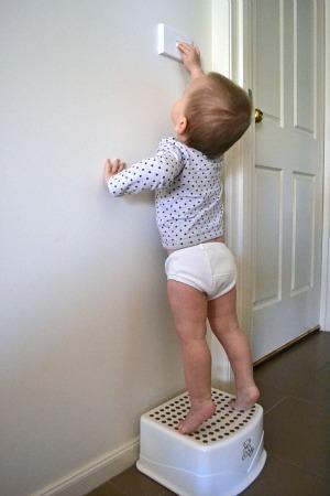 Otis reaching for the light switch