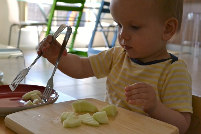 Transferring with tongs at 17 months