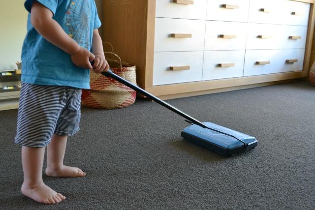 Otis using carper sweeper