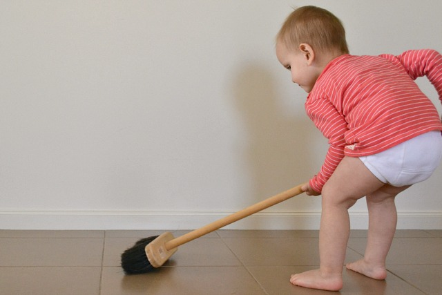 Toddler inside broom
