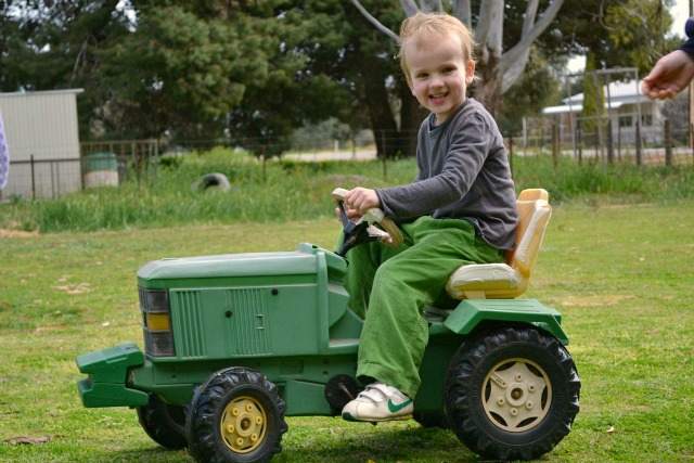 Caspar on little tractor