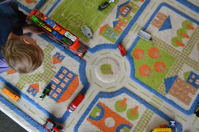 Caspar playing with cars on transportation mat
