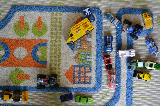 Cars on transportation mat