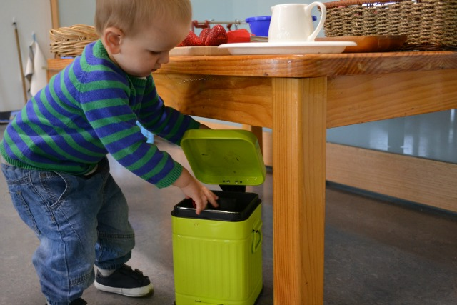 Otis putting waste into compost