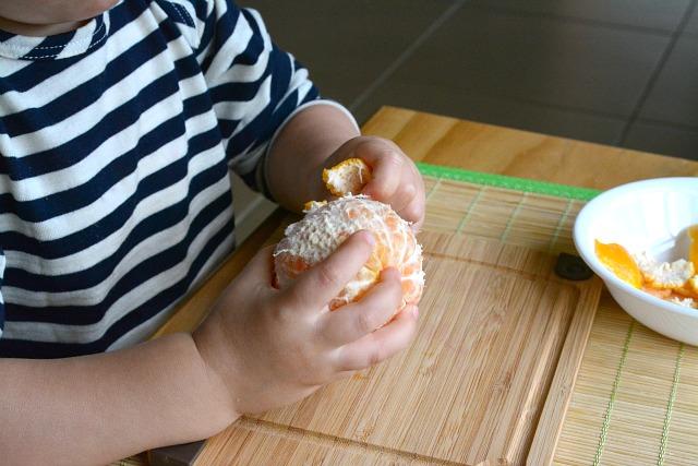 Otis 24 months peeling a mandarin