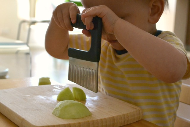 New skill - cutting (at 17 months)