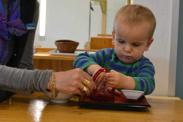 Otis being shown the strawberry slicer