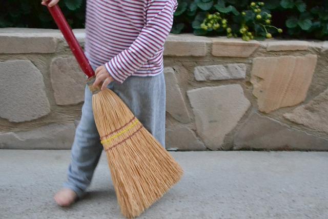 Toddler outside broom