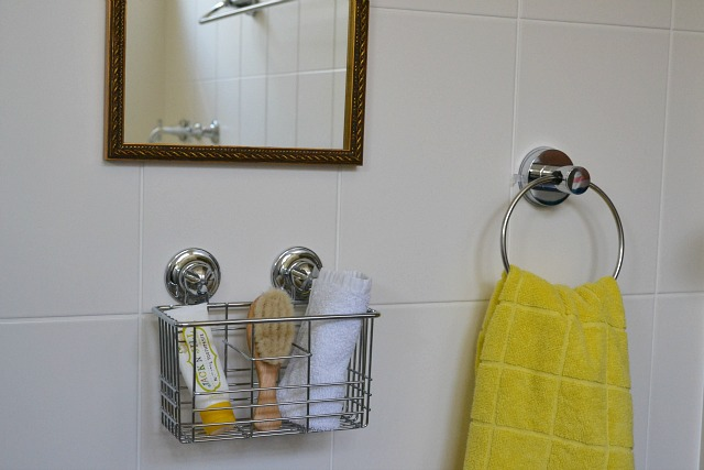 A bathroom for a toddler - low mirror and low basket/towel ring
