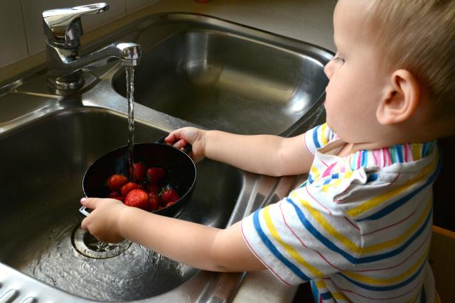 Washing strawberries - child sized colander
