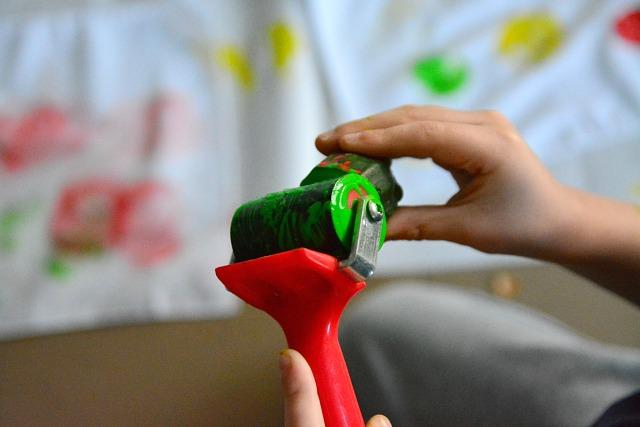 Caspar rolling paint onto zucchini