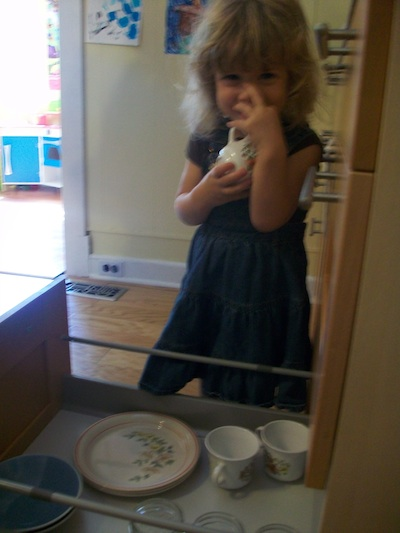 A low drawer or shelf with place setting items helps young children be independent in the kitchen