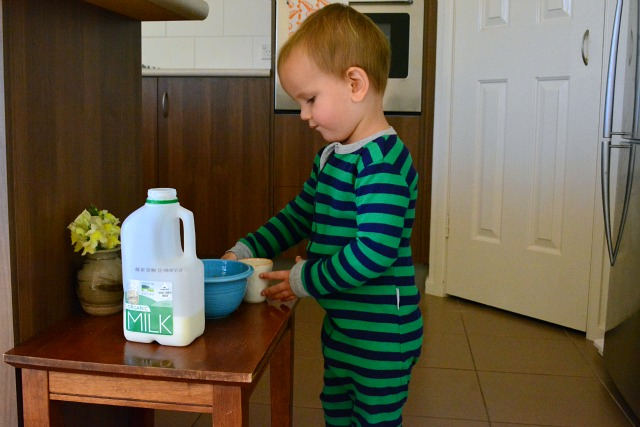 Otis preparing breakfast April 2013 at 24 months
