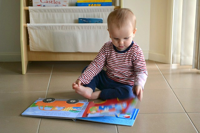 Otis reading at twelve months