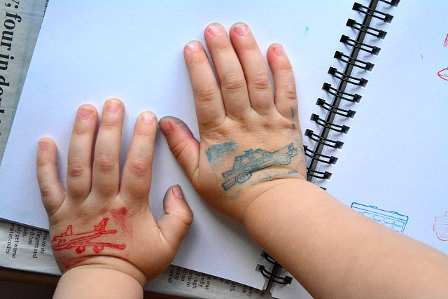 Otis's hands at 29 months  with stamps