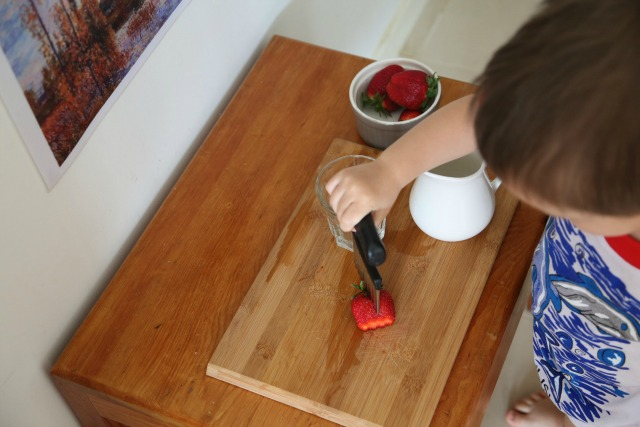 Joshua making snack