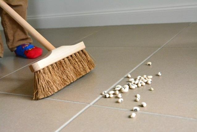 Otis sweeping with indoor broom