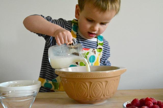 Otis pouring milk for pancakes