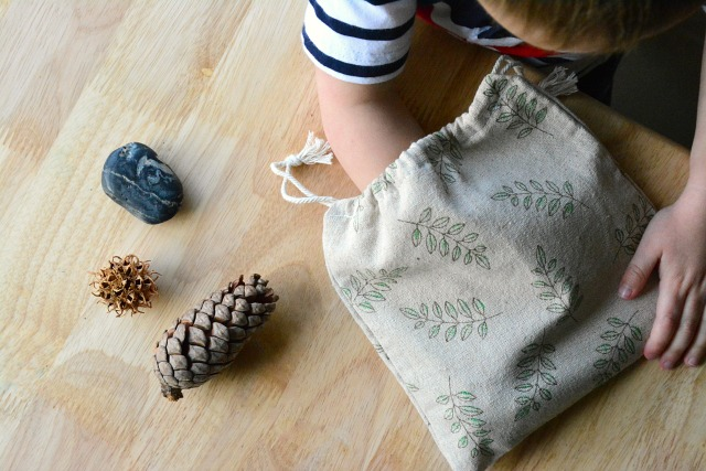 Child using Montessori Mystery Bag Stereognostic Bag