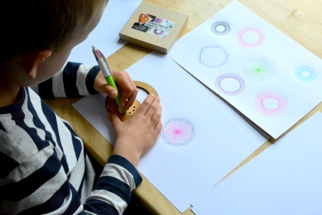 Caspar making spiral art at 6 yr September 2014