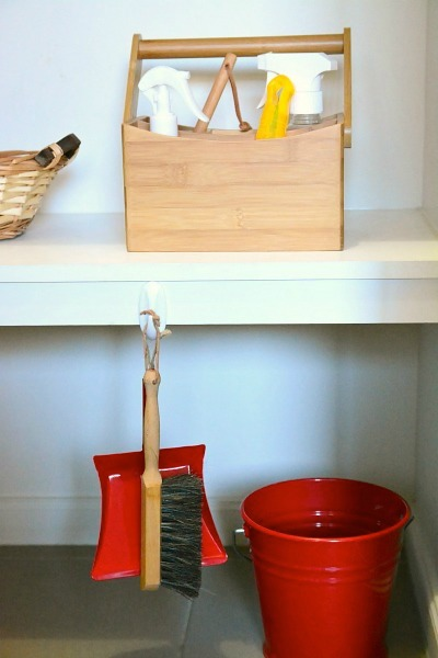 Toddler Cleaning Caddy on cleaning shelf at How we Montessori