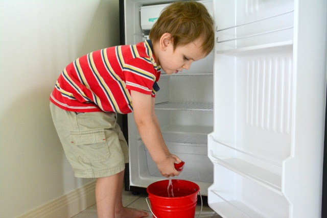 Otis cleaning:wiping the kids refrigerator Dec 2014 at three years *