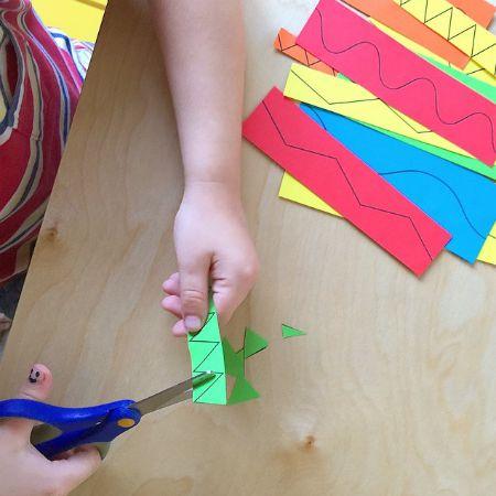 Cutting with scissors practice at How we Montessori