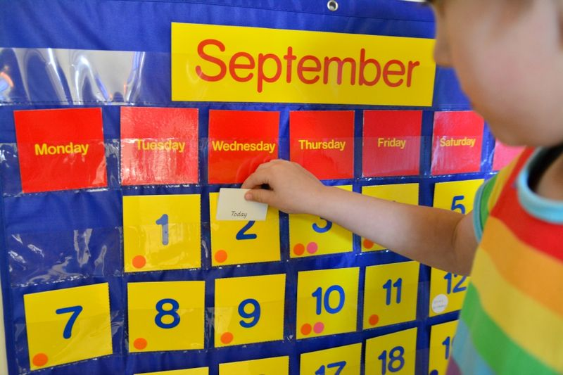 Otis labelling today at How we Montessori child days of the week, calendar