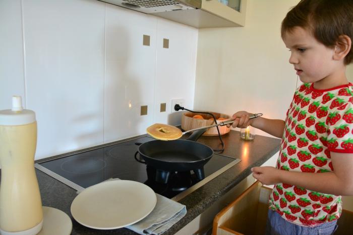 Otis at How we Montessori making pancakes 'o'