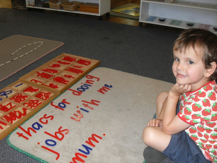 Otis at school with Movable Alphabet Work