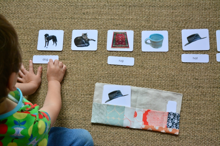 Otis using phonetic three part cards at How we Montessori