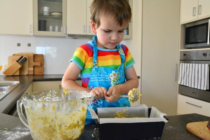 Otis making carrot zucchini slice into pan