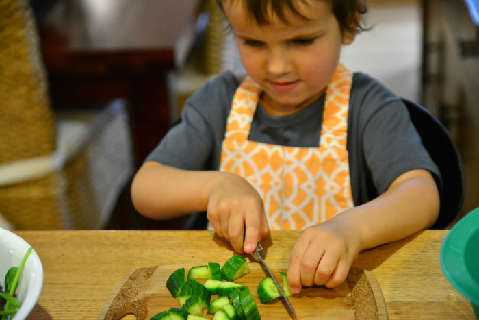 Otis cutting cucumber at Grandma's