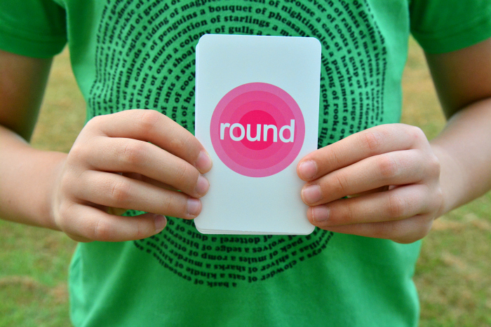 Caspar with round Go Find It Card, Sensory Nature Play at How we Montessori