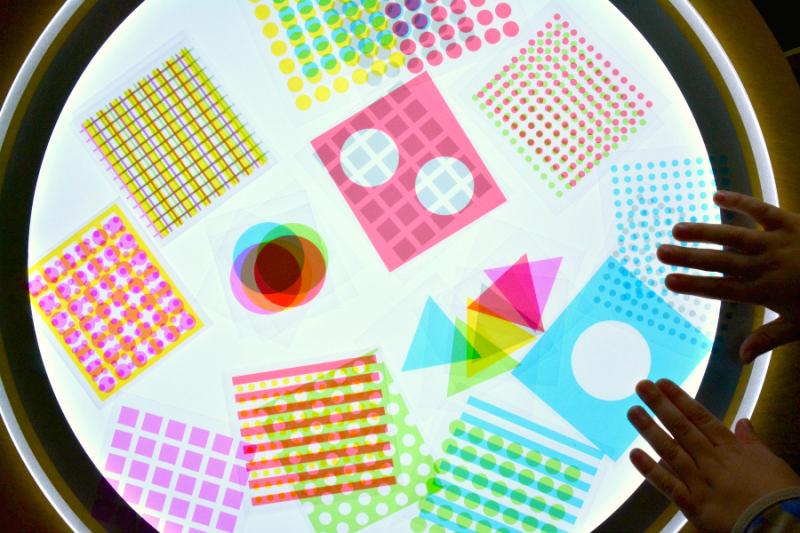Otsi using printed slides on LIght Table at How we Montessori