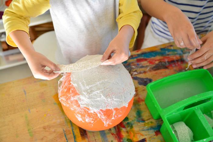 Otis making plaster bowl using a balloon