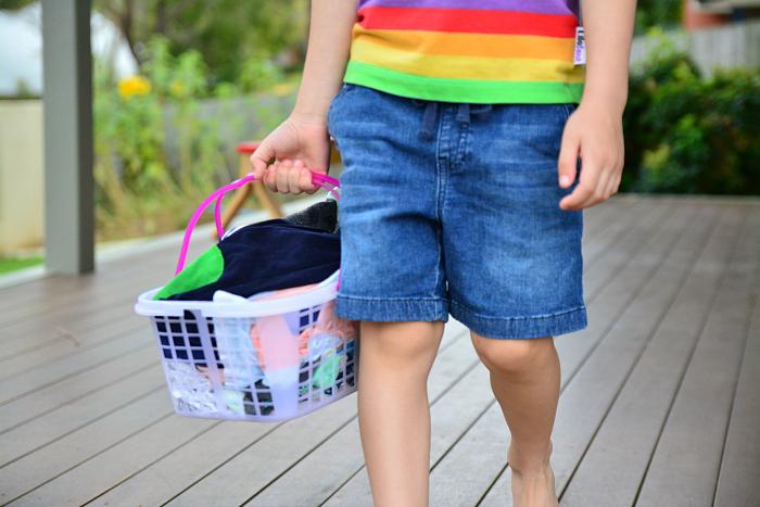 Otis with washing basket from Child.com.au