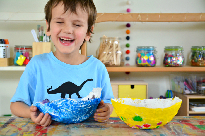 Otis with painted plaster bowls at How we Montessori - finished bowls