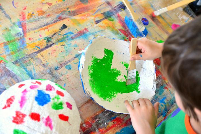 Otis painting his plaster bowl at HWM