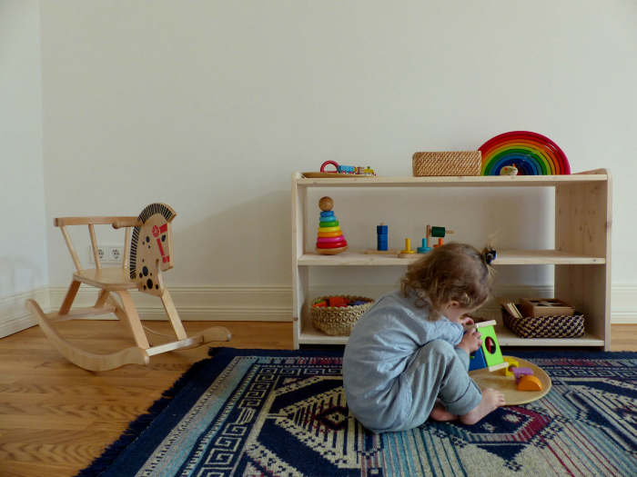 Montessori Home - shelves with age appropriate activities