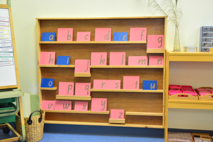 IMCH 3-5yr classroom Sandpaper letters on shelving at How we Montessori