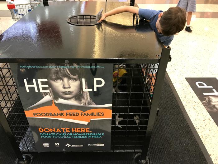 Otis donating to Foodbank Qld