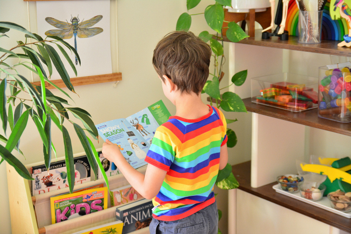 Otis reading Little Kids National Geographic Dec 2016 at How we Montessori