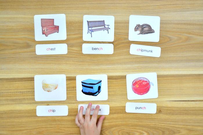 Otis using 'ch' phonogram three part cards at How we Montessori